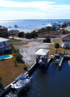 Enjoy beautiful Sound views from this deep water canal front site with boathouse , dock and lift!