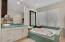 Beautiful master bathroom with whirlpool tub and oversized separate shower.