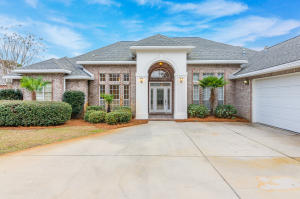 Stately entrance to this spacious pool home in the gated enclave of Magnolia Plantation.