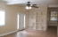 From the front entry, a very large living room with beautiful built in shelves