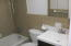 Tile surround and good size tub in the hall bath.