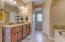Kitchen height dual vanity with granite top. 2 closets plus Linen closet.
