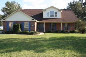 Brick home with vinyl trim for easy maintenance. Large corner lot.