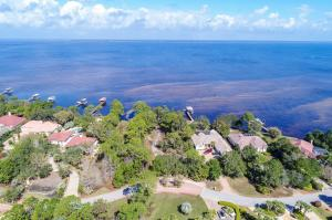 Spacious homesite with over 200 feet of waterfront views on the Choctawhatchee Bay.