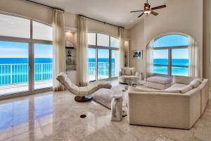Featuring endless Gulf views, soaring ceilings, and marble tile.