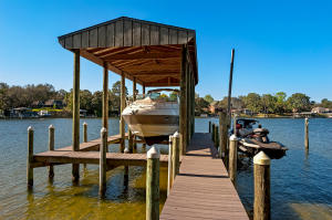 15,000lb boat lift, jet ski life and composite decking