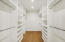 Huge walk in closet in master bedroom with cabinet grade solid wood shelving