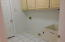 Laundry Room with overhead cabinets and laundry sink