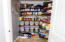 Pantry with wood shelving for easy organization.