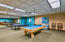 Gaming room with pool table, ping pong ball + more.