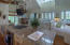 Second floor living and dining with cathedral ceilings