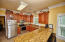 Unit A's Kitchen has granite countertops, Maple cabinets and Stainless steel appliances.