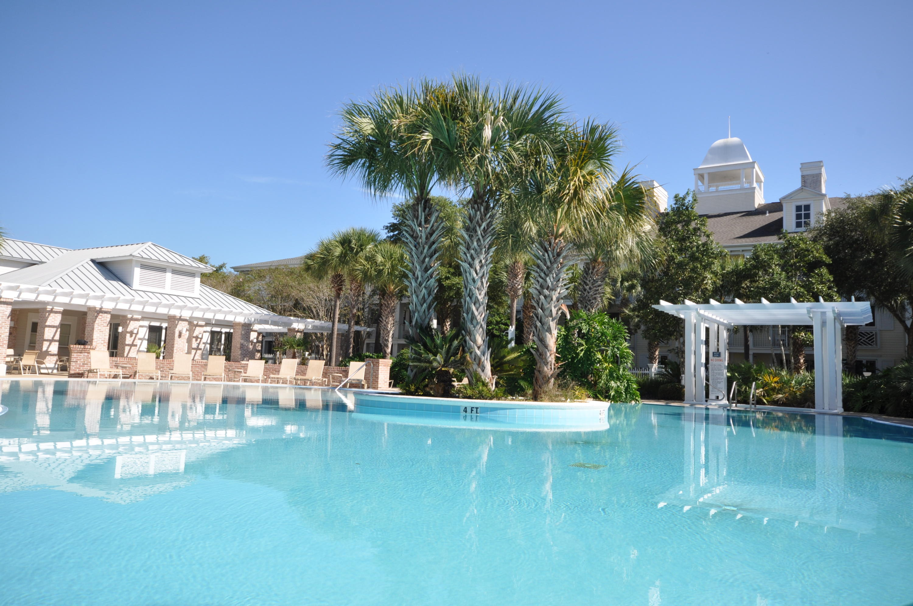 """$5000 PRICE REDUCTION on this POOL LEVEL condo with all tile floors sleeps 8.  Rental projections of $21,000 - $23,000 annually! Pilot House is located in the Village of Baytowne Wharf offering dining and entertainment options for all ages within Sandestin Golf and Beach Resort, a wonderful place to make memories with family and friends.  Pilot House owners also have access to the Founder's Club Room, a gathering spot for larger groups with bar and pool table, TVs, etc. Sandestin owners have access to the private owners' beach, 2 pools, tennis and 3 golf courses as well as a grocery store, many restaurants, movies, and even Sacred Heart Hospital without having to get on Highway 98.  This 3rd level condo is so convenient to the pool, fitness center and green space as well as parking below. As an introduction to the Sandestin lifestyle, we invite our new owners to explore amenities that make Sandestin special. The listing brokerage and seller(s) are presenting the buyer(s) of this property with (2) 90-minute rounds of Tennis court time, a golf foursome at one of our three championship courses, a round of golf for up to four (4) players and an invitation to """"Club Night"""" at the unrivaled Burnt Pine Golf Club.  Sandestin Golf and Beach Resort is a major destination for all seasons and all ages, and has been named the #1 resort on Florida's Emerald Coast. This magical resort spanning over 2,000 acres is comprised of over 70 unique neighborhoods of condominiums, villas, town homes, and estates.  The resort features miles of sandy white beaches and pristine bay front, four championship golf courses, a world-class tennis center with 15 courts, 4 resort swimming pools (and 15 private neighborhood pools), a 113-slip marina, a fully equipped and professionally staffed fitness center and spa, meeting spaces and The Village of Baytowne Wharf, a charming pedestrian village with events, shopping, dining, family entertainment and nightlife. For true golf cart community living, Grand"""