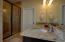 Master bathroom with granite countertop and double sink vanity