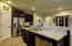 Stainless appliances complete this beautiful kitchen