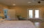 View of Master bedroom looking toward the french doors leading to Pool area.