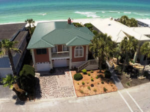 Aerial view of house and Emerald Green Gulf waters