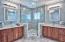 His and Her's sinks in master bathroom between walk-in shower.
