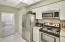 Kitchen with stainless steel appliances, granite counters and back splash.