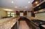 Tiled backsplash, Granite Counters, Custom Cabinetry, HUGE Island with Breakfast Bar.