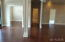 Ceramic wood tile floor in the main living areas. Foyer and entry of the home.