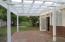 Level backyard with brick paver patio.