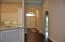 Entrance to home with Archways, wood flooring. PHOTOS ARE FROM A PREVIOUS HOME/SAME PLAN.