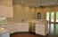 enjoy entertaining, the Open Kitchen to Great Room , with breakfast bar and cabinets galore. PHOTOS ARE FROM PREVIOUS HOME/SAME PLAN