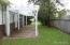 Fenced back yard with pergola.