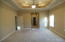 Master bedroom with his and her walk in closets, treyed ceilings and Florida room exit.