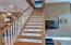 Beautiful hardwood floors lead to expansive hardwood stairway