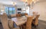 Upscale dining area with coastal furnishing and lighting influences