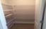 Driftwood Walk in Pantry with Ventilated Shelving.