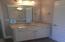 Bathroom Vanites include cultured marble countertops and satin nickel lighting.