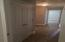 Split floor plan offers 3 bedrooms and separate bath with hallway storage closet. IMG_7326