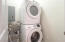 Full sized washer dryer in laundry room