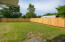 NEWLY INSTALLED PRIVACY FENCE. SPRINKLER SYSTEM