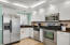 Renovated kitchen with stainless appliances and granite
