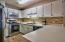 "New !! Easy to maintain ""wood like"" tile floor, stainless steel appliances & backsplash"