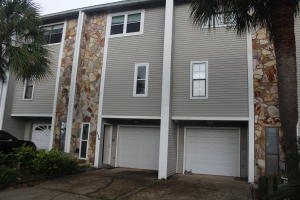 Waterfront town home with attached deep water boat slip, suitable for power or sail boats. Great condition and move in ready. Extensive decks on the back side of this unit have great views of the Choctawhatchee Bay. Close to all the bases and NW Fl regional airport. Exterior view of front of unit on the left.