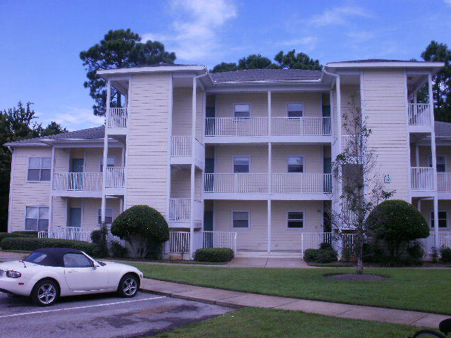 Located in best Multi-living location in the area. Five minutes from the beach and walking distance to up-scale shopping at the Grand Blvd. Minutes from Scared Heart hospital. Unit has 9ft ceillings and all appliances are included. Sewer and trash included in HOA fee.