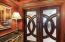 Elegant wood & glass double doors.