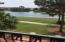 Balcony overlooks the pool to the lake and the golf course