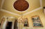Custom faux ceiling treatment with accent lighting