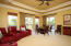 Grand scale room with balcony overlooks the pool and golf course