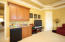 Wet bar with custom cabinets and refrigerator