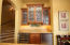 Handsome cabinetry, wine cooler, refrigerator, and ice maker