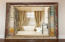 Antique French Doors lead into Guest Bath in Living Room Area and just off of guest bedroom