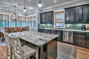 Large well-equipped kitchen with Viking appliance package allows the cooks to prepare and socialize with everyone in an open and comfortable space.