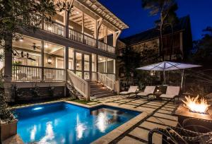 Lush private backyard with new pool, firepit, summer kitchen and table and chairs